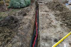 pokládka vody a elektřiny k podzemní nádrži na deš'tovou vodu